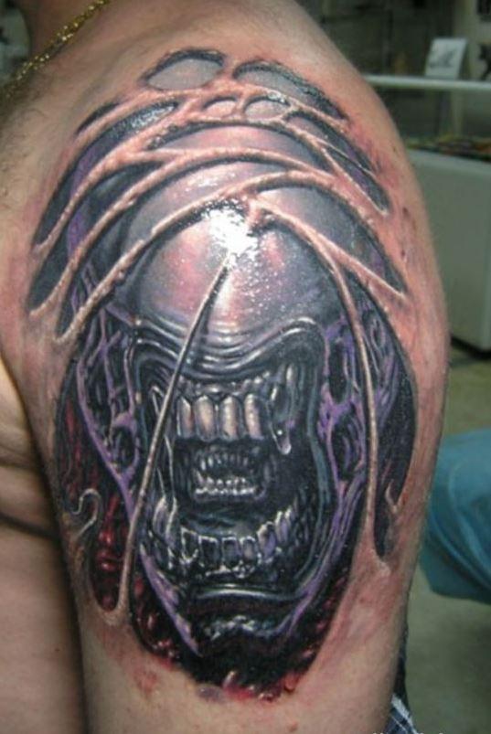 Evil scary alien tattoo on shoulder for men