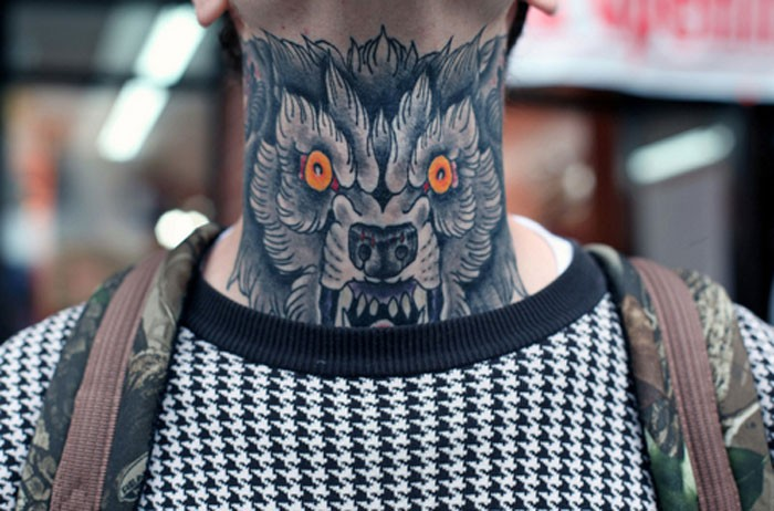 Evil wolf with red eyes tattoo on neck