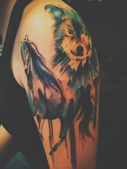Excellent wolf watercolor tattoo on arm for women