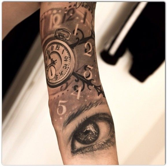Eyes and watch tattoo on arm by Jak Connolly