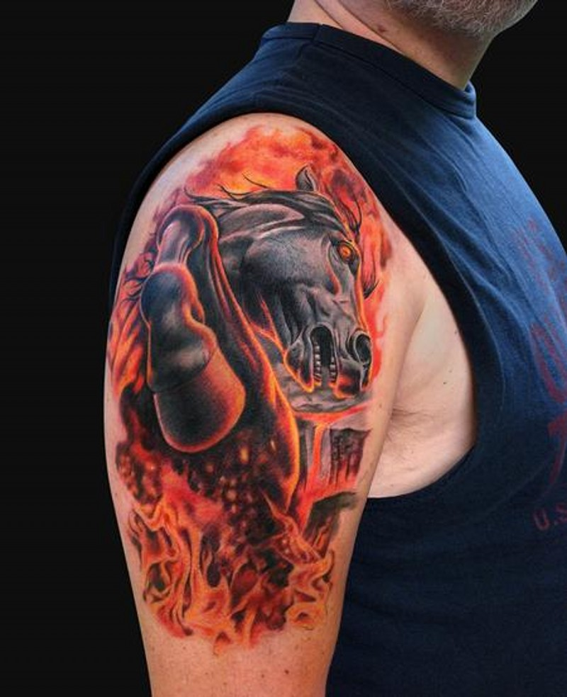 Fabulous colored shoulder tattoo of running horse in flames