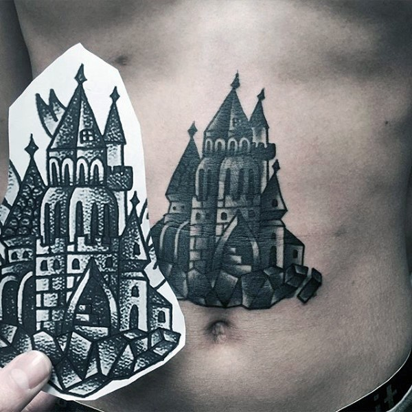 Fairy tale old school black and white detailed castle tattoo on belly