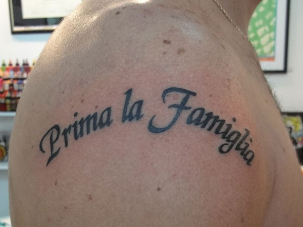 Family comes first tattoo on shoulder