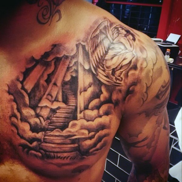 Fantastic black and white stairs to haven with angle tattoo on chest