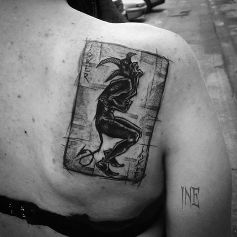 Fantastic  black ink scapular tattoo by Inez Janiak of Joker card