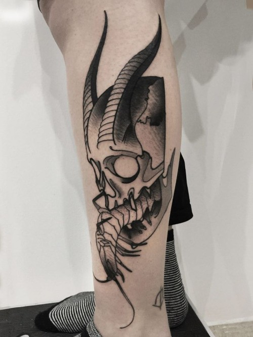 Fantastic blackwork style painted by Michele Zingales leg tattoo of demonic skull