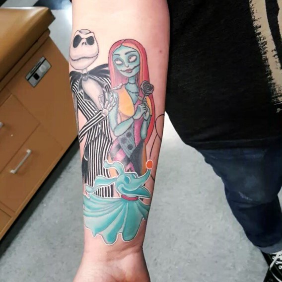 Fantastic colored detailed usual monster couple tattoo on forearm