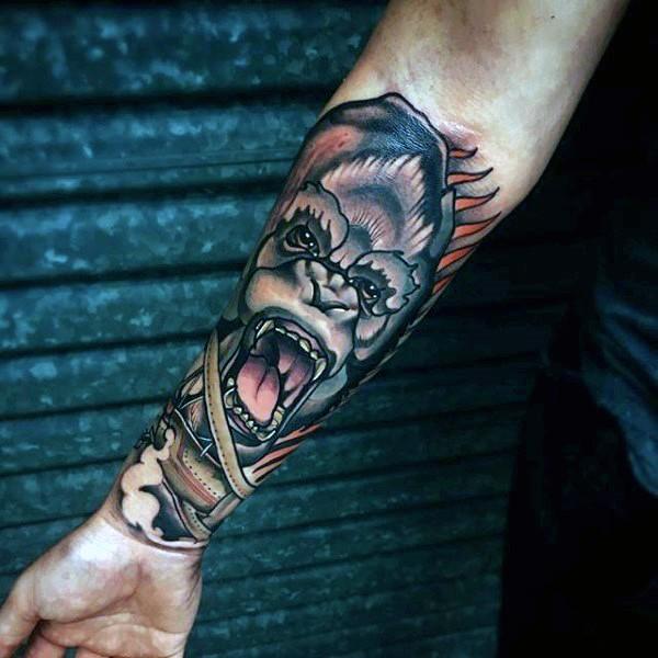 Fantastic designed and colored forearm tattoo of monkey head