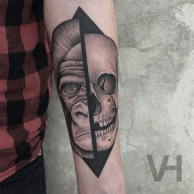 Fantastic designed by Valentin Hirsch split tattoo of human skull and gorilla head