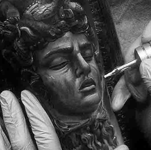 Fantastic designed very realistic looking black and white Medusa head tattoo on arm