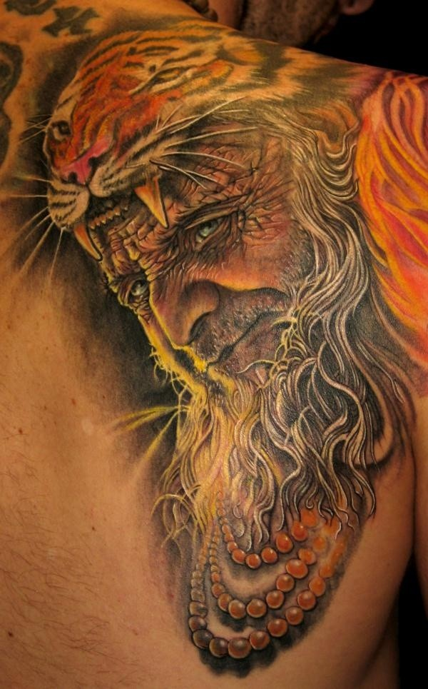 Fantastic detailed and colored old man with tiger helmet tattoo on shoulder