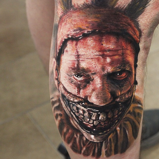 Fantastic detailed and painted creepy monster man tattoo on thigh