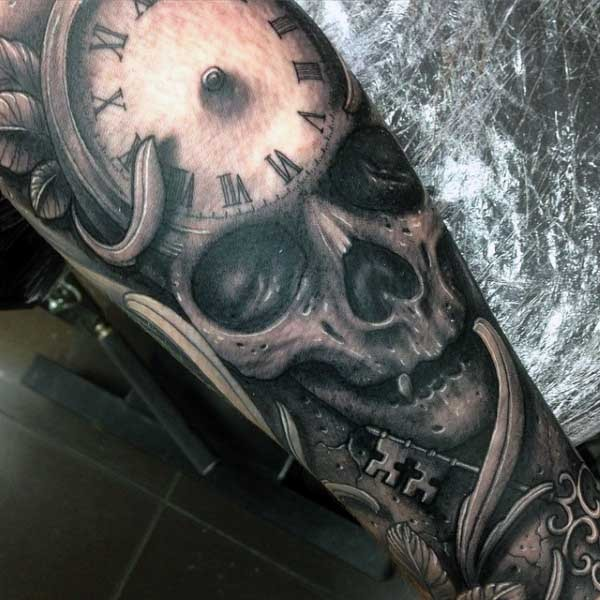 Fantastic detailed black ink skull with clock and antic key tattoo on arm