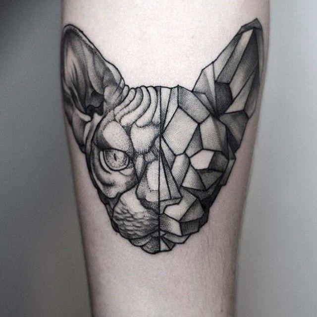 Fantastic dot style leg tattoo of half real half stone cat head