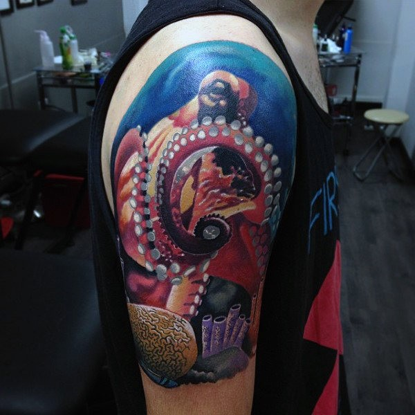Fantastic looking colored creative upper arm tattoo of large orctopus