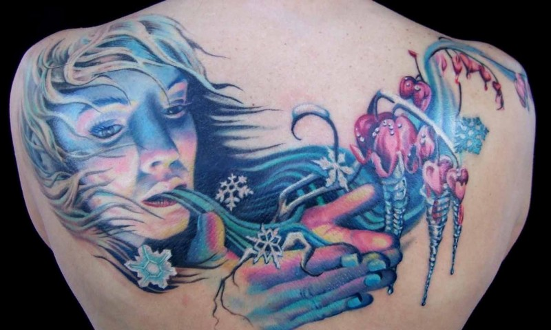 Fantastic looking colored upper back tattoo of frosty woman with flowers