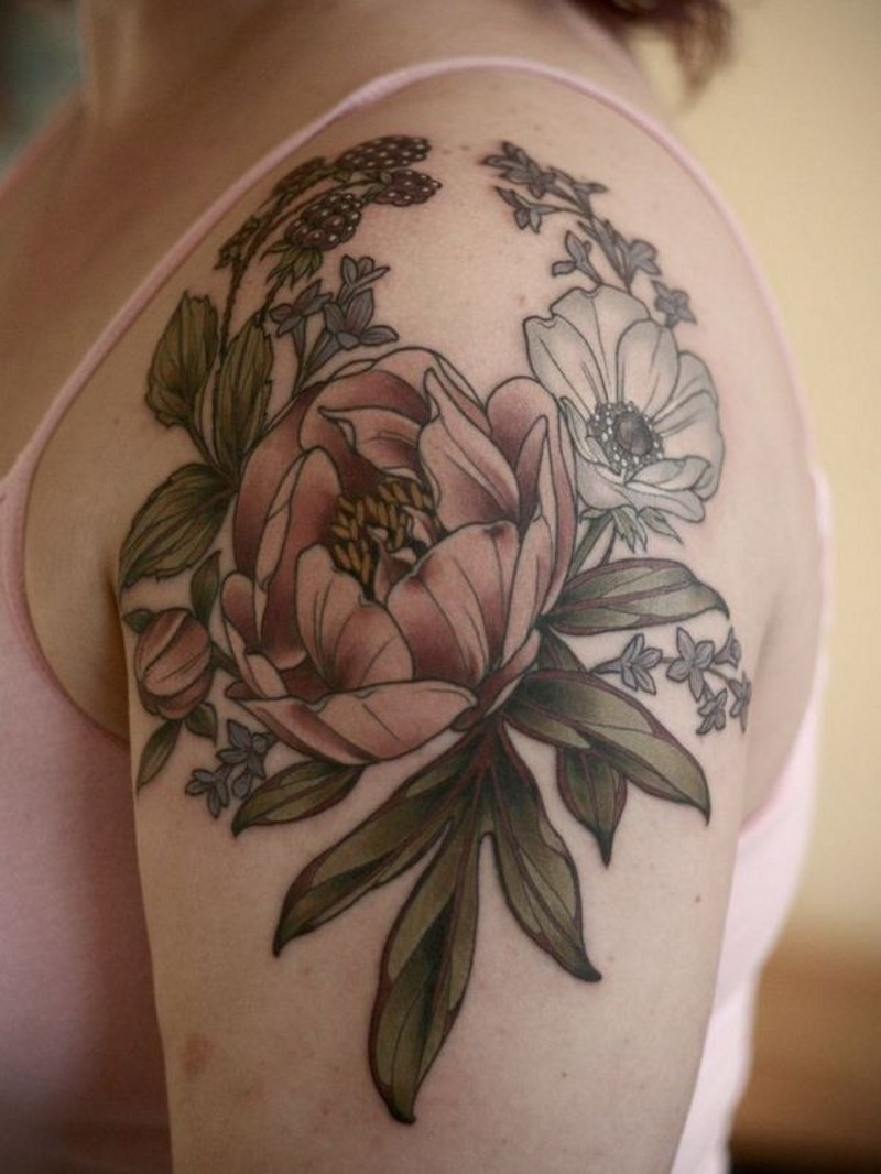 Fantastic looking natural colored wild life flowers tattoo on shoulder combined with berries