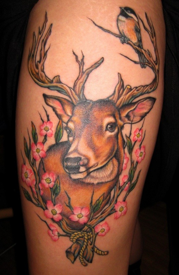 Fantastic natural looking colored sweet deer with flowers tattoo on shoulder