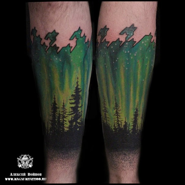 Fantastic painted and colored arm tattoo of night glowing sky with forest
