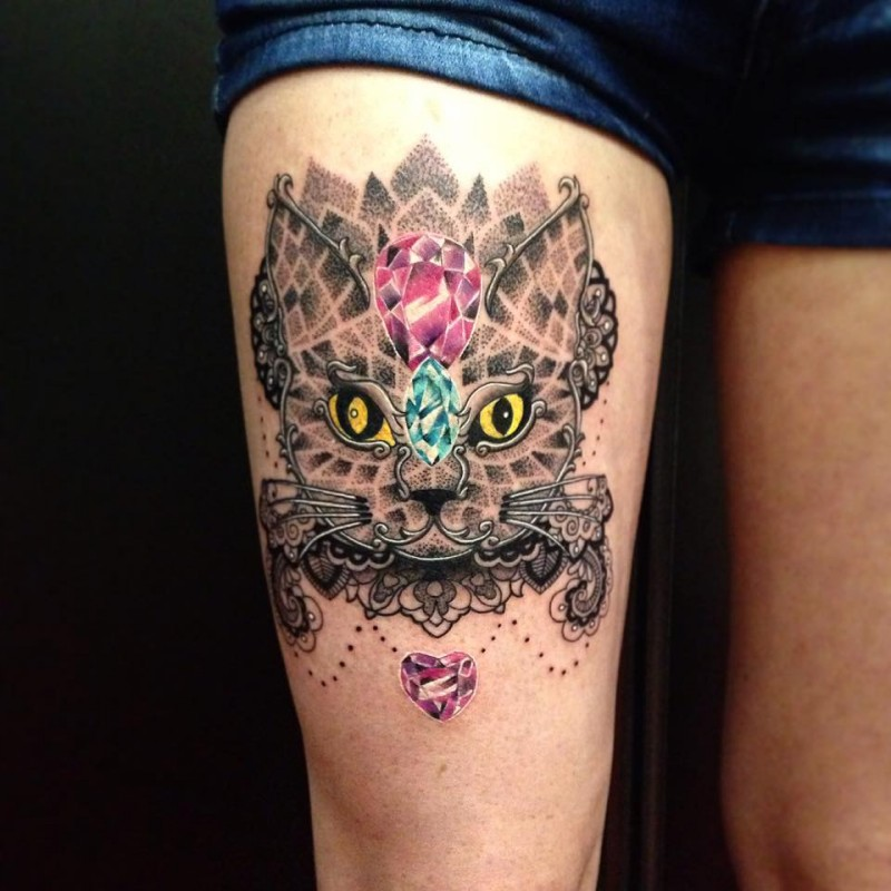 Fantastic painted and colored creepy cat with diamonds tattoo on thigh
