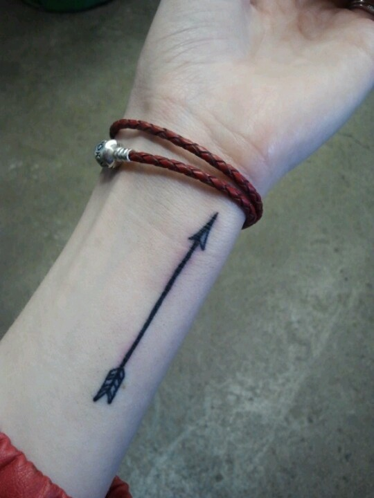 Fantastic painted black arrow tattoo