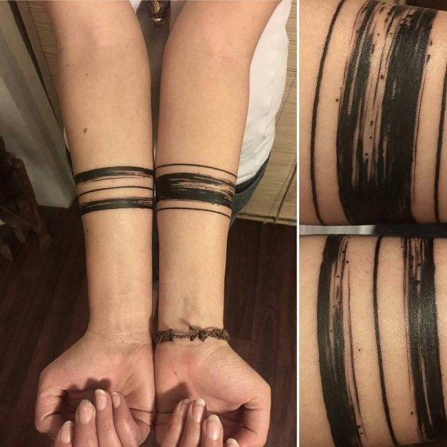 Fantastic painted black ink forearm tattoo of corrupted parallel lines