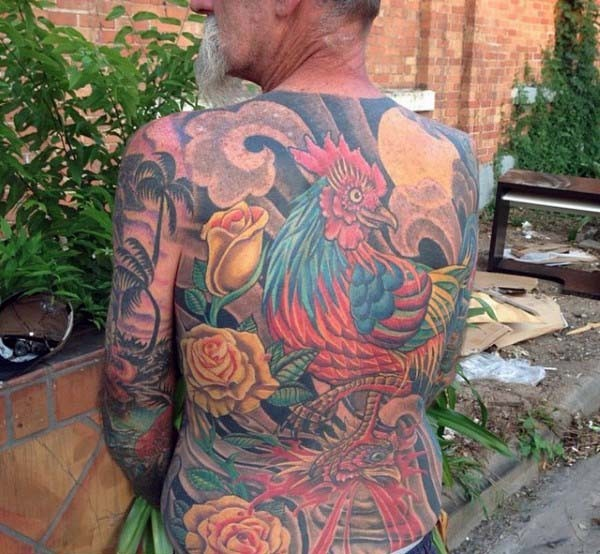 Fantastic painted massive colorful tattoo with flowers and cock on whole back
