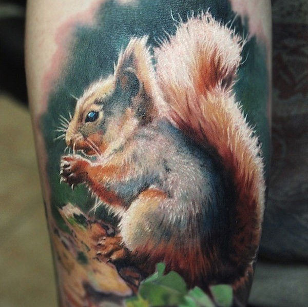 Fantastic real photo like natural colored big squirrel tattoo on thigh