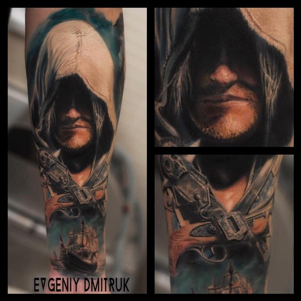 Fantastic style colored forearm tattoo of man with hood and crossed pistols