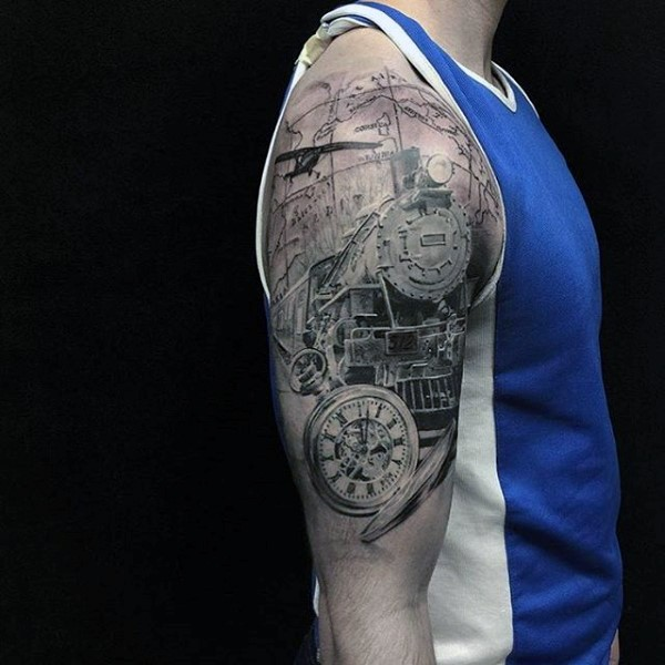Fantastic very detailed black and white train shoulder area tattoo