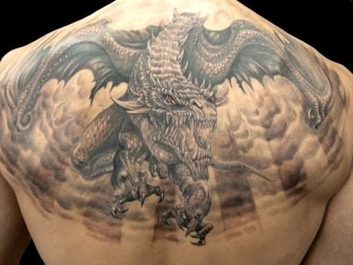 Fantastic very detailed black ink detailed upper back tattoo of evil dragon