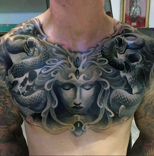 Fantasy like black and white Medusa with snakes tattoo on chest