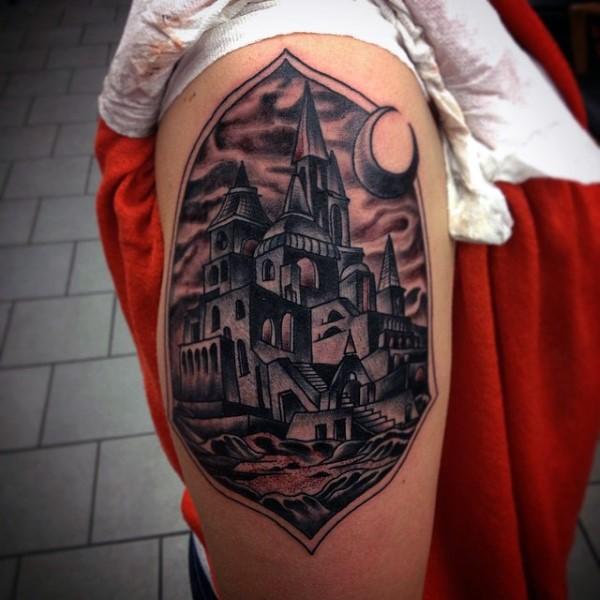 Fantasy like black ink mystical castle tattoo on thigh