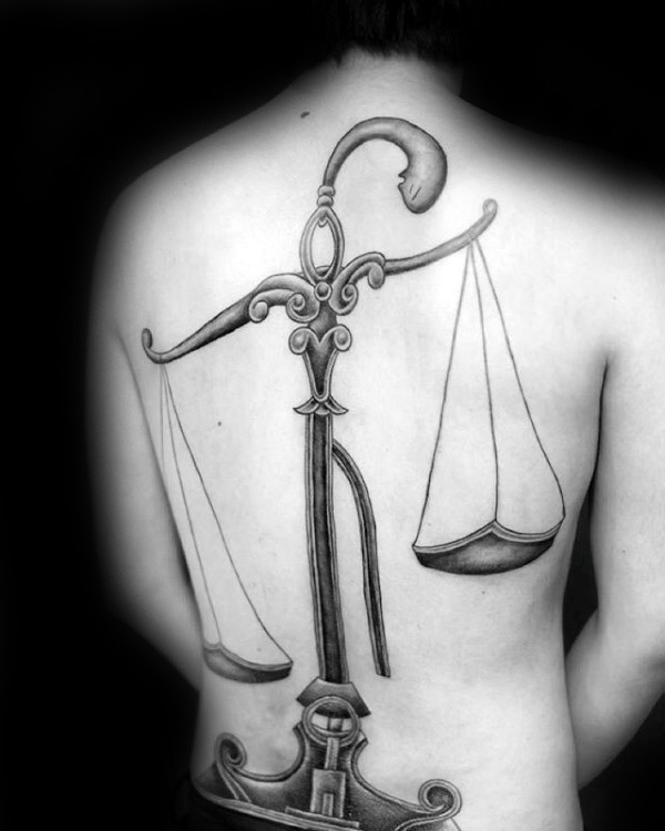 Fantasy style black ink whole back tattoo of simple libra