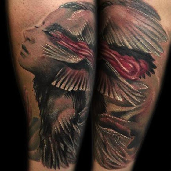 Fantasy style colored arm tattoo of mystical woman with wings