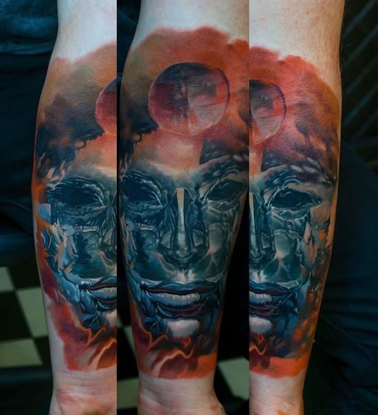Fantasy style colored arm tattoo of incredible mask with planet