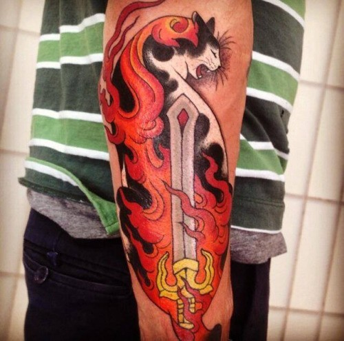 Fantasy style colored arm tattoo of Manmon cat with burning sword