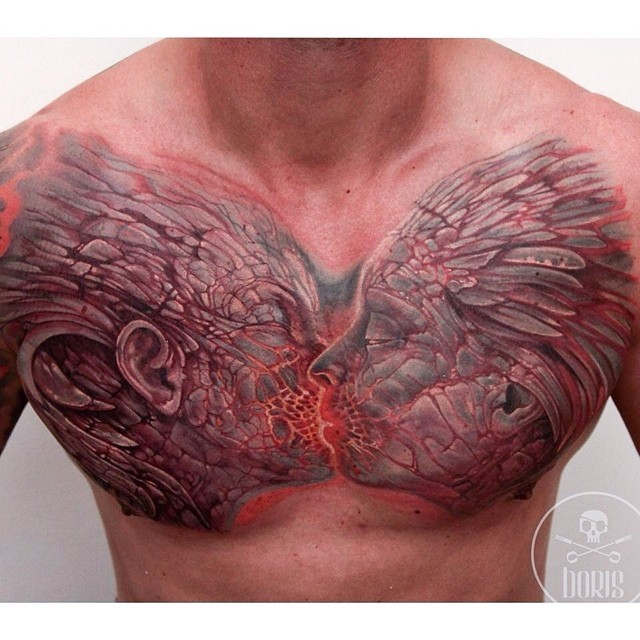 Fantasy style colored chest tattoo of kissing demons couple