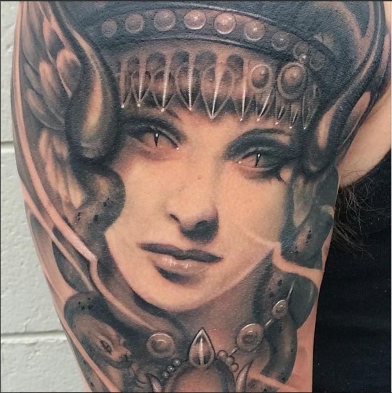 Fantasy style colored demonic woman face tattoo on shoulder