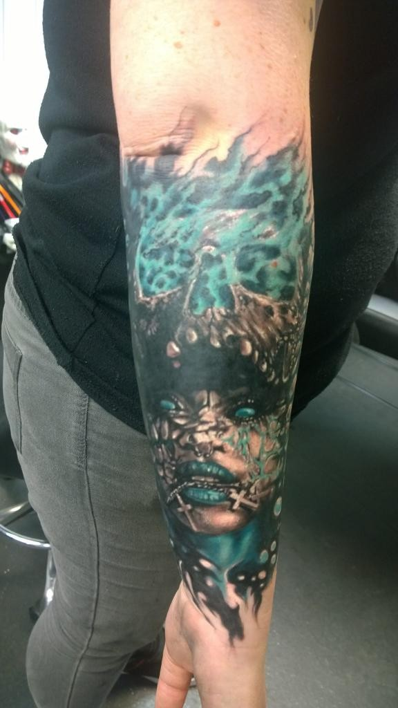 Fantasy style colored hand tattoo of burning skull with woman face