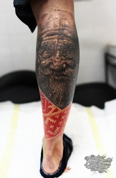 Fantasy style colored leg tattoo of creepy old man face