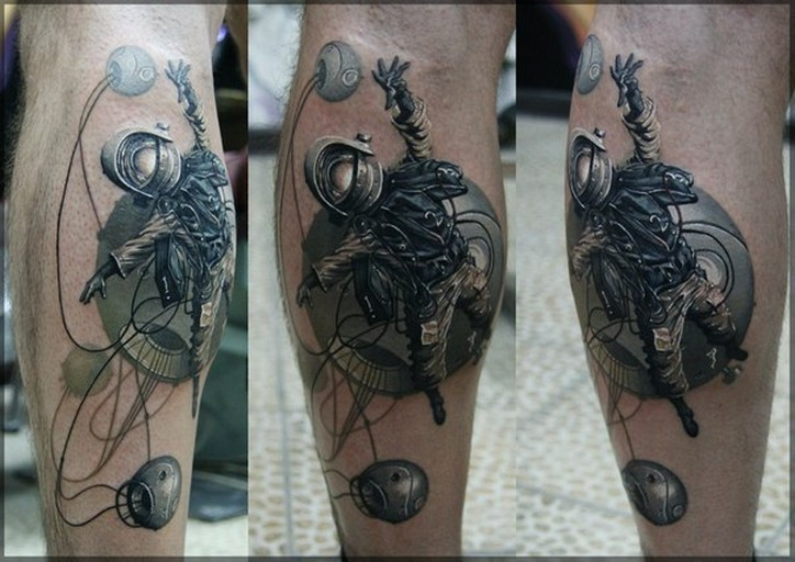Fantasy style colored leg tattoo of space man with roped planets