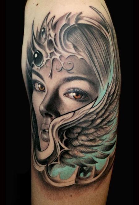 Fantasy style colored shoulder tattoo of woman with wing