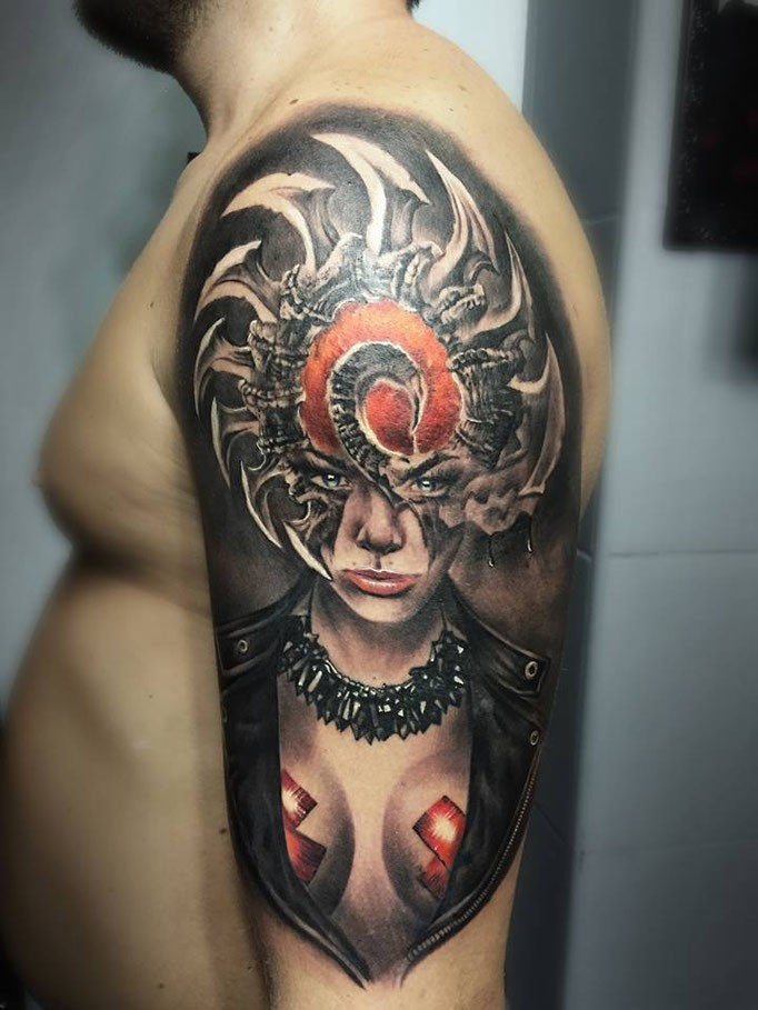 Fantasy style colored shoulder tattoo of tribal woman