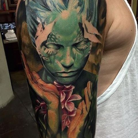 Fantasy style colored shoulder tattoo of incredible woman with flowers