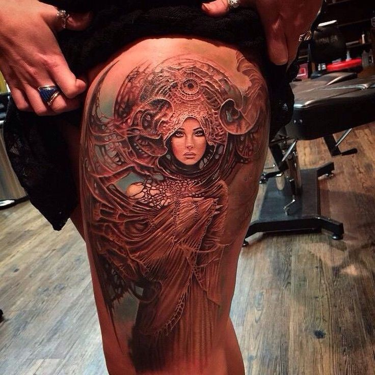 Fantasy style colored thigh tattoo of beautiful woman