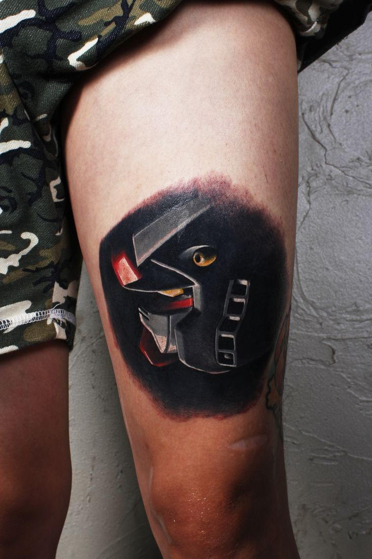 Fantasy style colored thigh tattoo of robot head