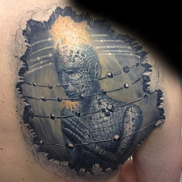 Fantasy style detailed scapular tattoo of strange looking statue with flames