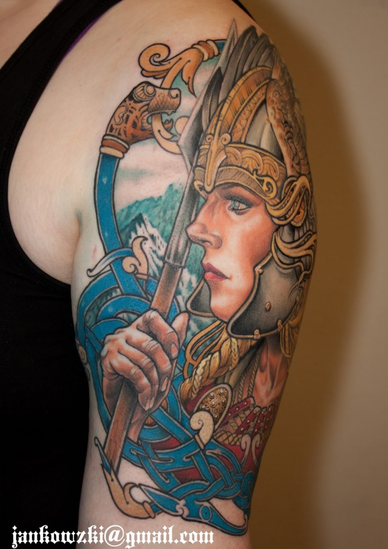 Fantasy style illustrative shoulder tattoo of woman with cool helemet