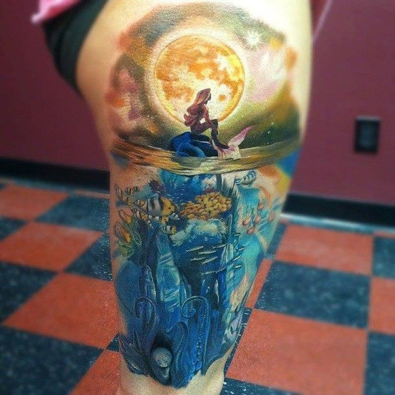 Fantasy world beautiful painted multicolored underwater life with mermaid and big moon tattoo on thigh